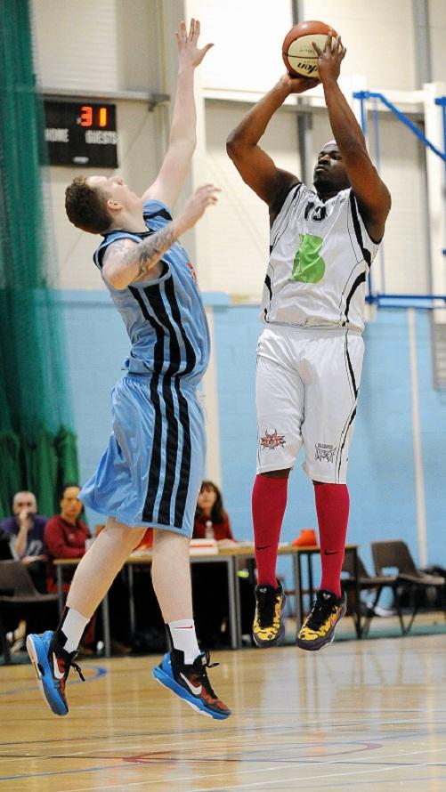 Bradford Dragons' Vance Silcott shoots under pressure from Derby's Jeff Smith