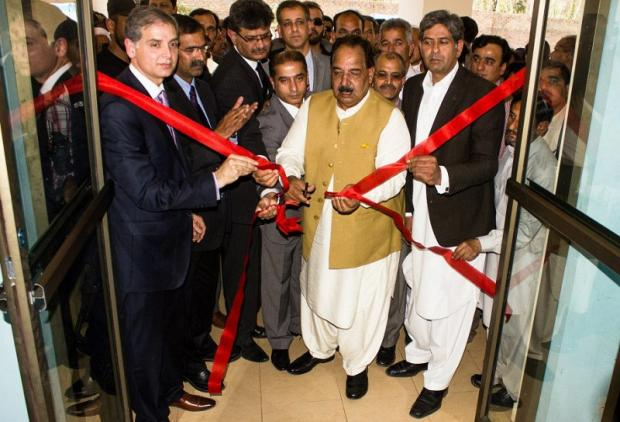 The red tape is cut and the new hospital in Azad Kashmir is officially opened as dignitaries and doctors gather round