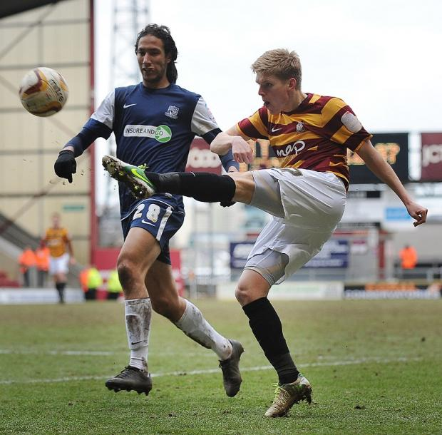 Quiz master supreme Alan Connell whips in a cross under pressure from Bilel Mohsni during the 2-2 draw with Southend on Good Friday
