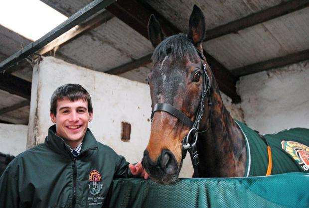 Jockey Ryan Mania with Grand National winner Auroras Encore at his stable in Bingley earlier today