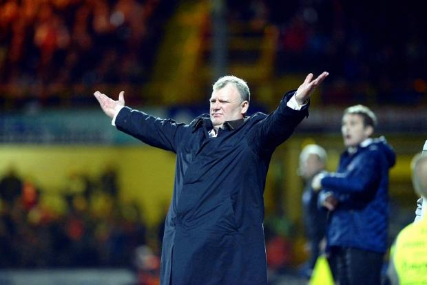 Steve Evans gestures on the touchline during his Rotherham side's midweek victory at Valley Parade