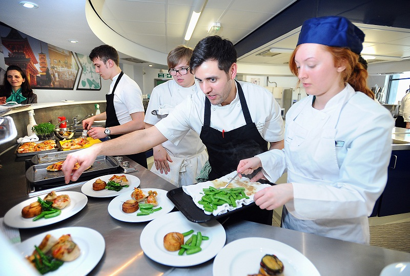 Students at the Food and Travel studio learn from staff of The Box Tree restaurant in Ilkley