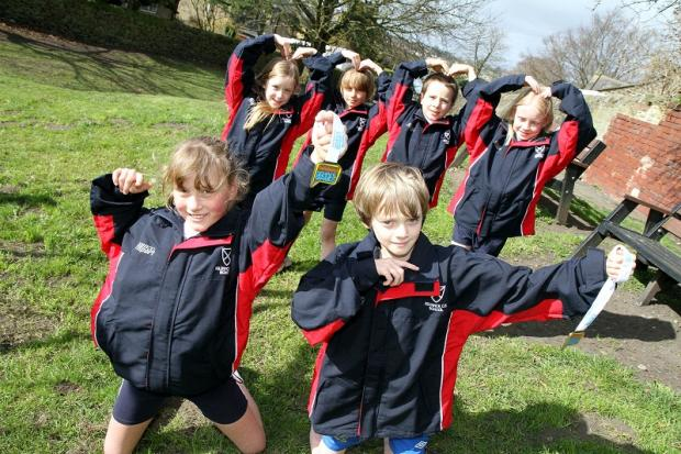 Celebrations: Kildwick Primary School's successful cross-country team, (front) Lucy Fryers, Luke Butterfield with, from left, Millie Barker, Wilf Roberts, Max Hibbert and Lilli Carr