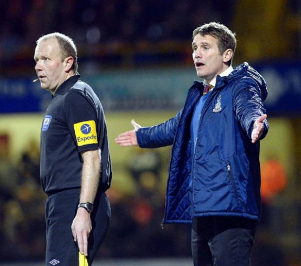 REF JUSTICE: Phil Parkinson queries another decision during the defeat to Rotherham