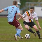 Park Avenue's goal-scorer Ross Daly takes on Colwyn Bay's John McKenna