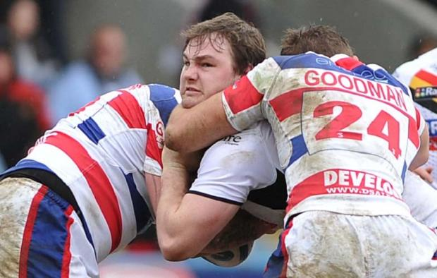 Ben Evans gets collared in the Challenge Cup tie at Rochdale