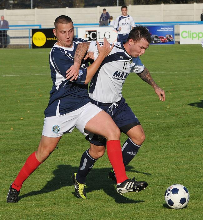 Andy Pearson, left, seen playing for Hyde against Guiseley, scored for the Lions in their shock defeat