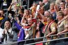 Gary Jones and Ricky Ravenhill lift the League Two play-off final trophy