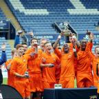 NATIONAL CHAMPIONS: City's under-15s hoist the winners' trophy aloft
