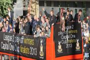 The players' open-top buses arrive in Centenary Square