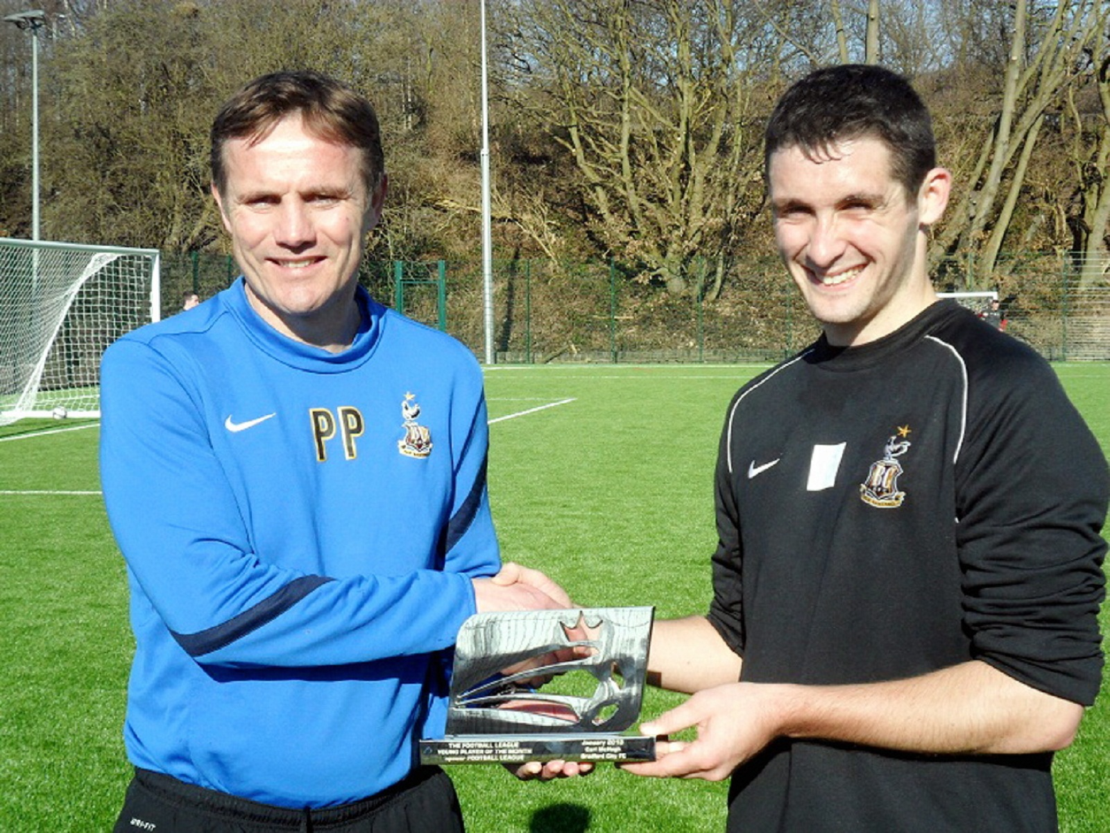 Carl McHugh, pictured receiving his young player of the month award from Phil Parkinson, has displayed real maturity in big games