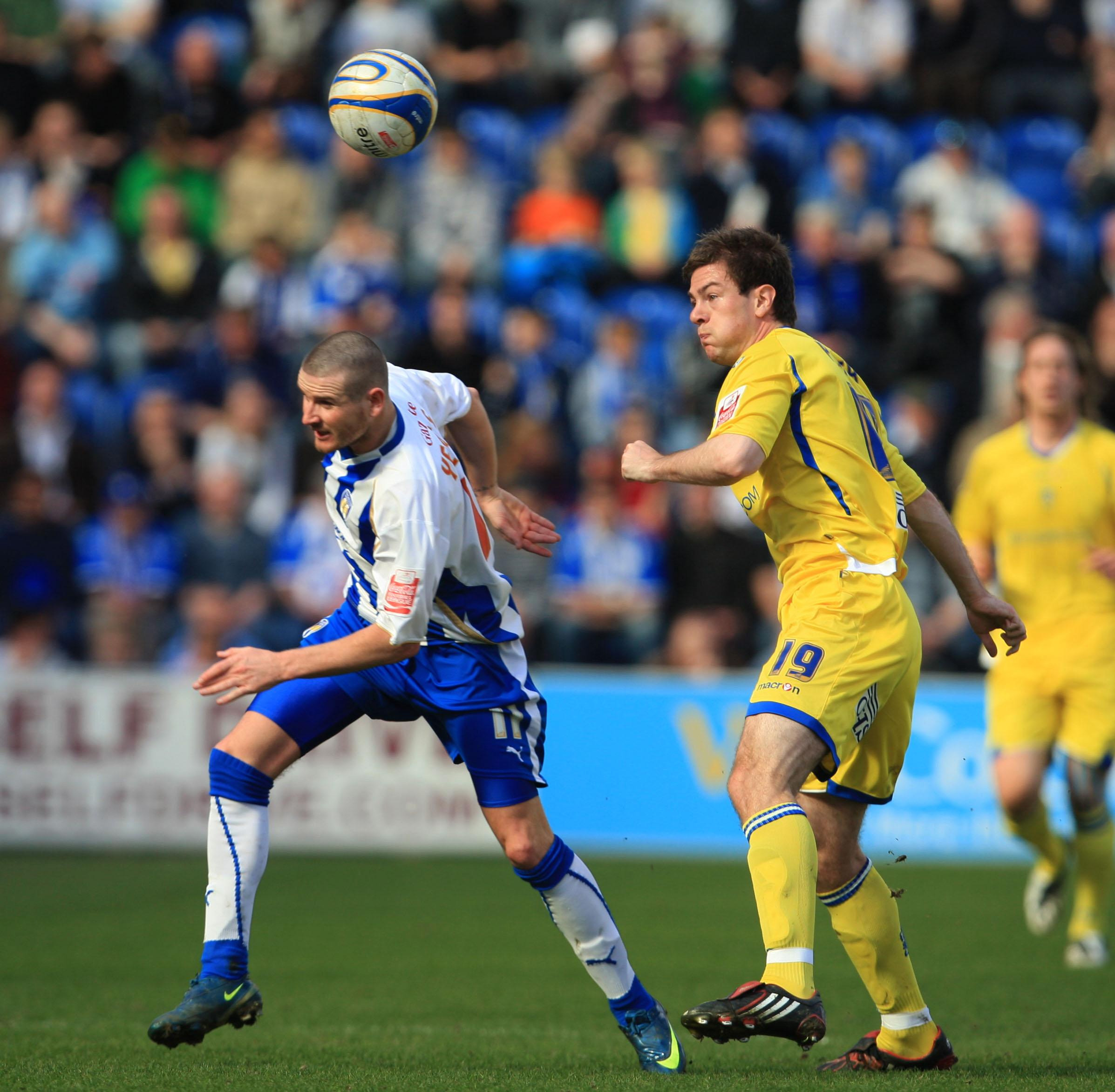 Mark Yeates in action for Colchester against Leeds' former City loanee Ben Parker
