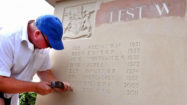 Stonemason Jonathan Albutt at work on the new memorial