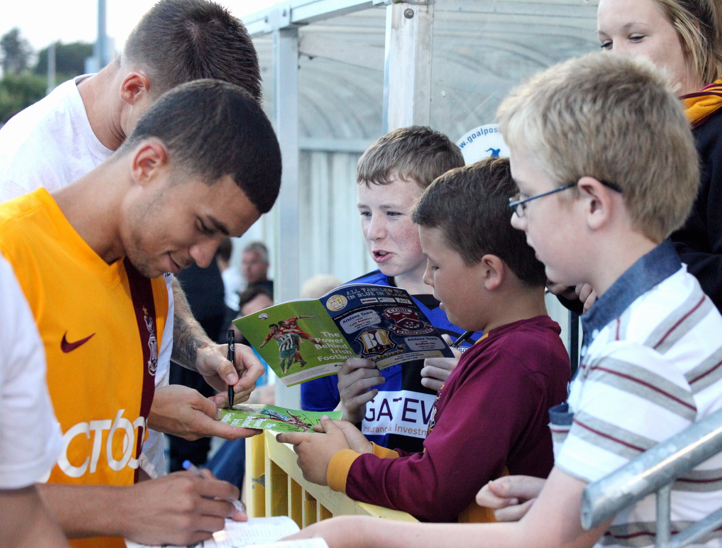 Nahki Wells signs autographs for fans after City's 4-1 victory at Athlone, when he scored the equaliser