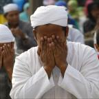 Bradford Telegraph and Argus: Indonesian Muslims offer Eid al-Fitr prayers that marks the end of the holy fasting month of Ramadan in Jakarta, Indonesia, Thursday, Aug. 8, 2013.