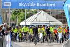 Professinal cyclist Josh Edmondson leads off the Bradford Sky Ride followed by thousands of cyclists from across the district