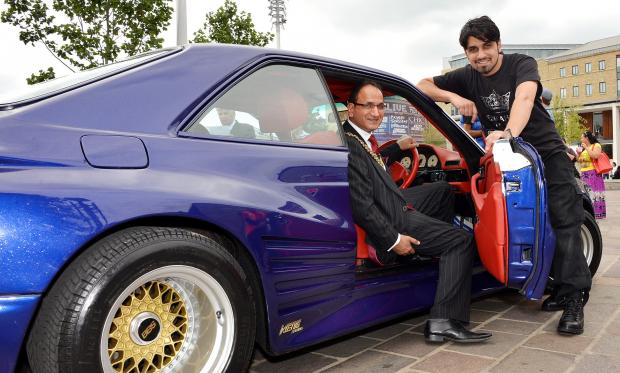 The Lord Mayor of Bradford, Coun Khadim Hussain, views a customised Mercedes with Naveed Khan