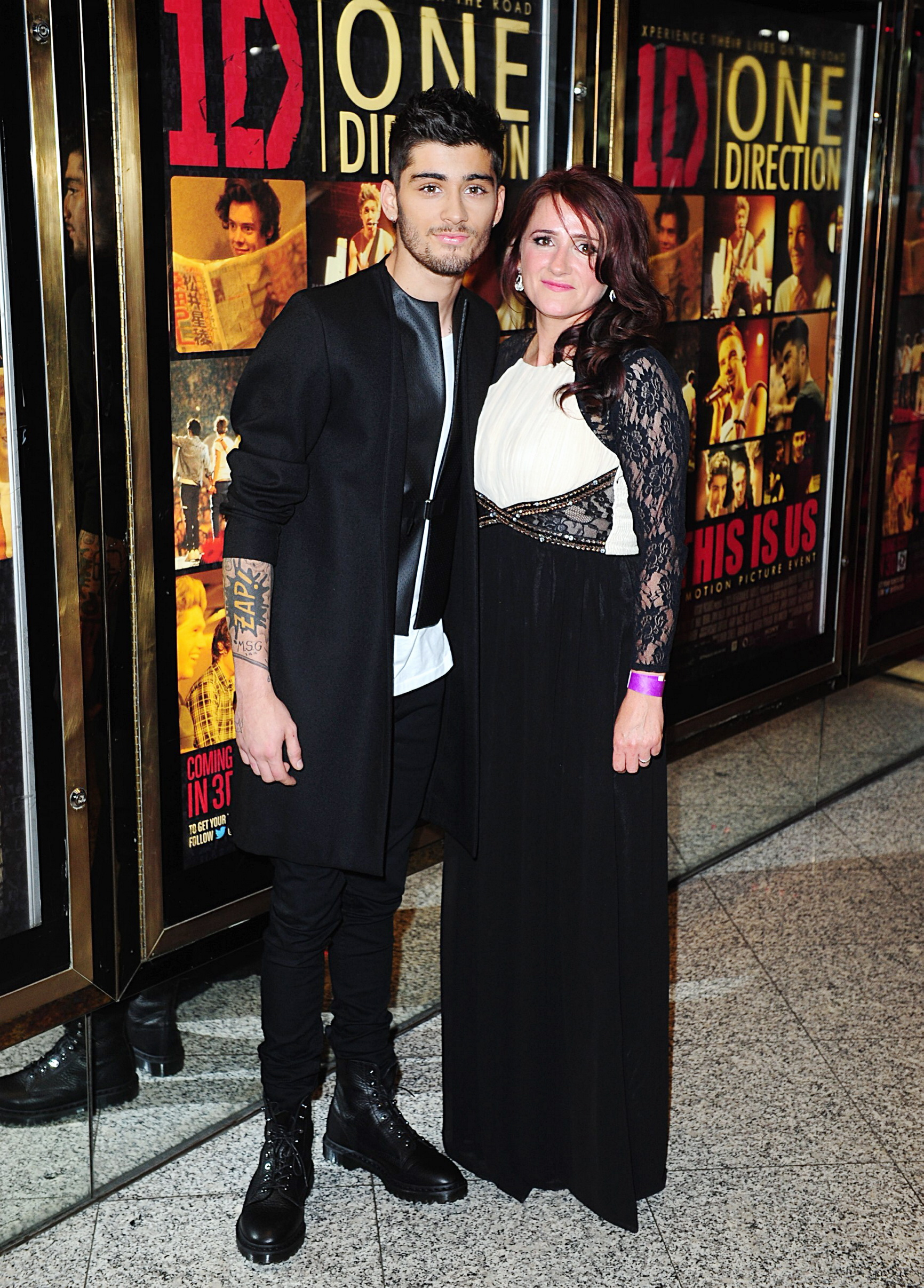 Bradford Telegraph and Argus: Zayn Malik with his mother Trisha Malik arriving for the World Premiere of One Direction: This Is Us, at the Empire Leicester Square, London
