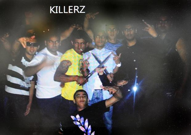 A still from the video showing the 'gang' with machetes