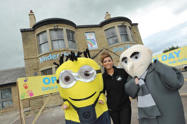 Danielle Dixon with members of staff in Despicable Me costume outside her new nursery
