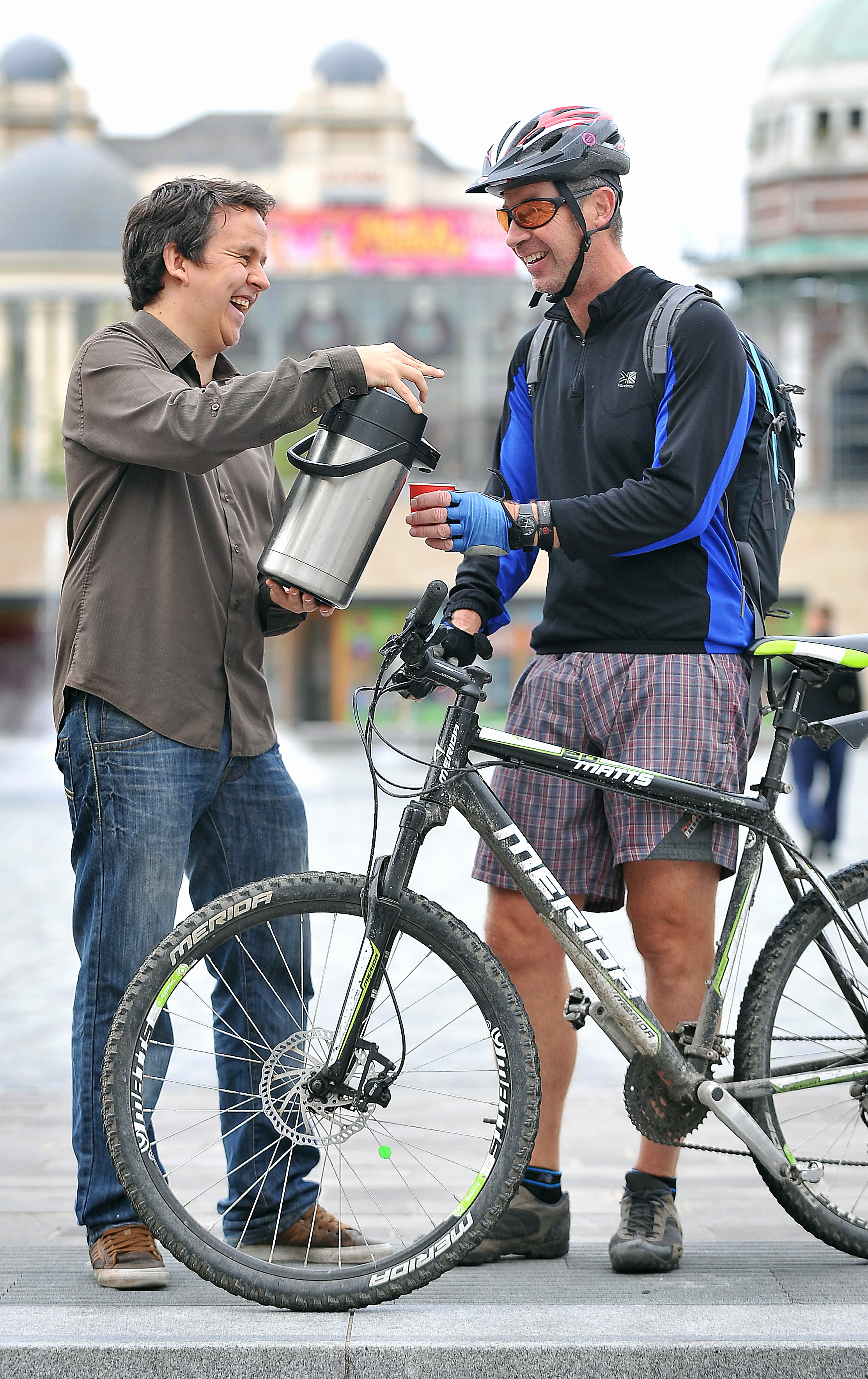 Tom Jones from Bradford Council pours cyclist, Ian Taylor, a coffee in City Park for the free Bike Breakfast to celebrate National Cycle to Work Day on September 12 last year