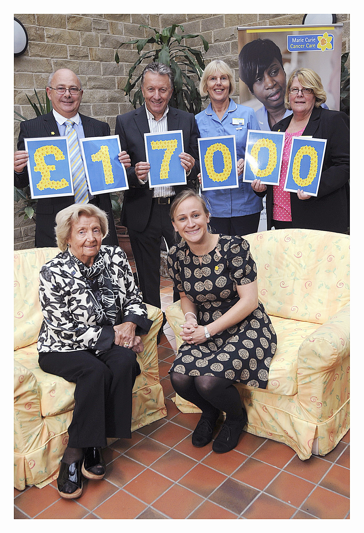 At the launch are (back, from left  Brian Curran, Poundworld boss Chris Edwards, Marie Curie nurse Lydia Lepp, hospice manager Elaine Hill and (front) Alice Edwards and Joanna Hancock