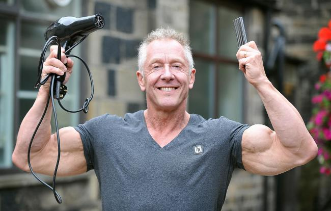 Hairdresser David Steca at his barbershop in Otley after qualifying for the Mr Universe competition