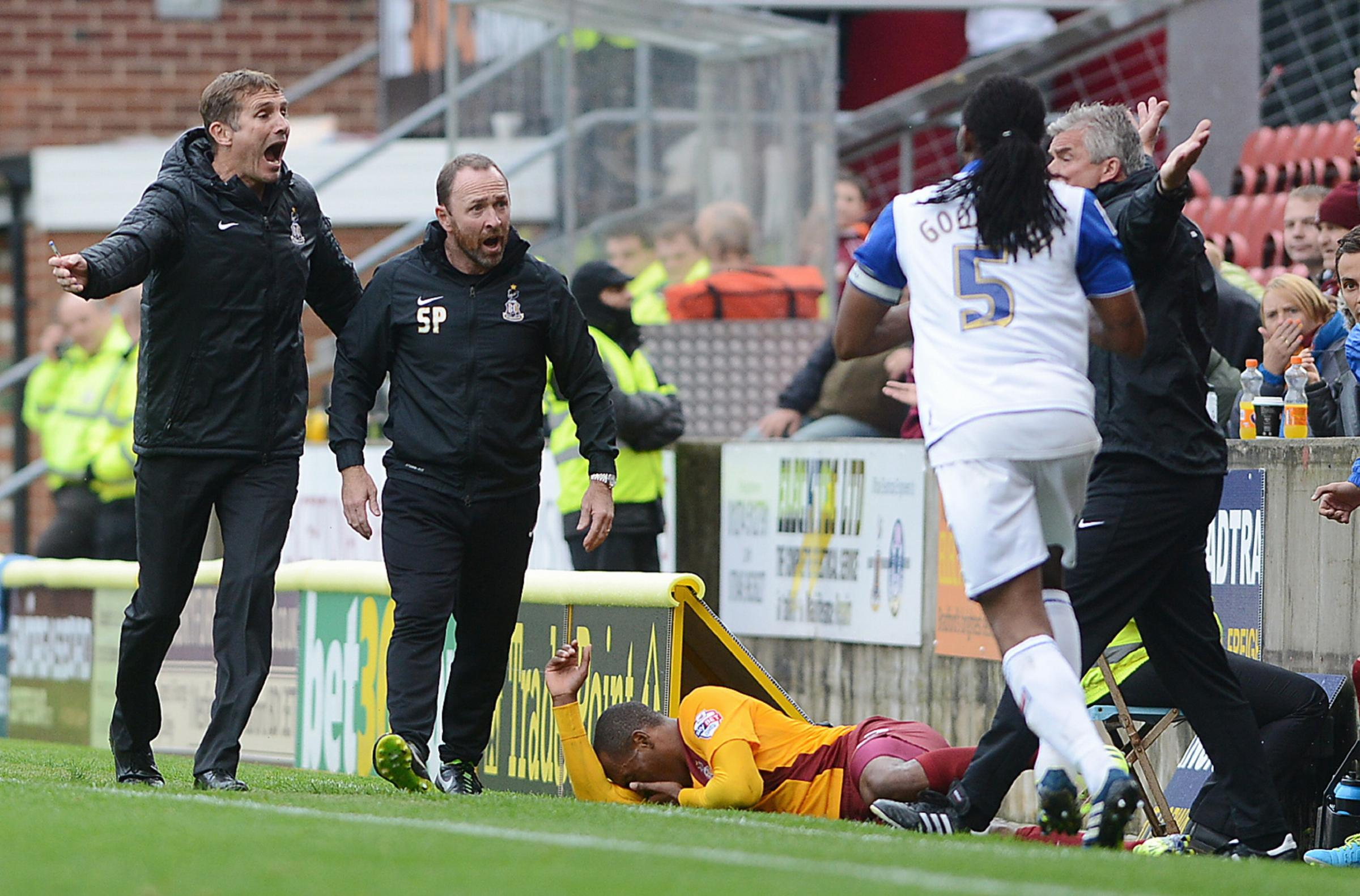 FLASHBACK: Kyel Reid is flattened by a challenge from Ian Goodison which left City's management furious when the sides met at Valley Parade last October. The defender escaped with a yellow card and Tranmere went on to win 1-0