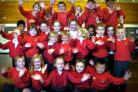 Pupils at Eldwick Primary School celebrate the Ofsted report which ranked the school among the country's elite