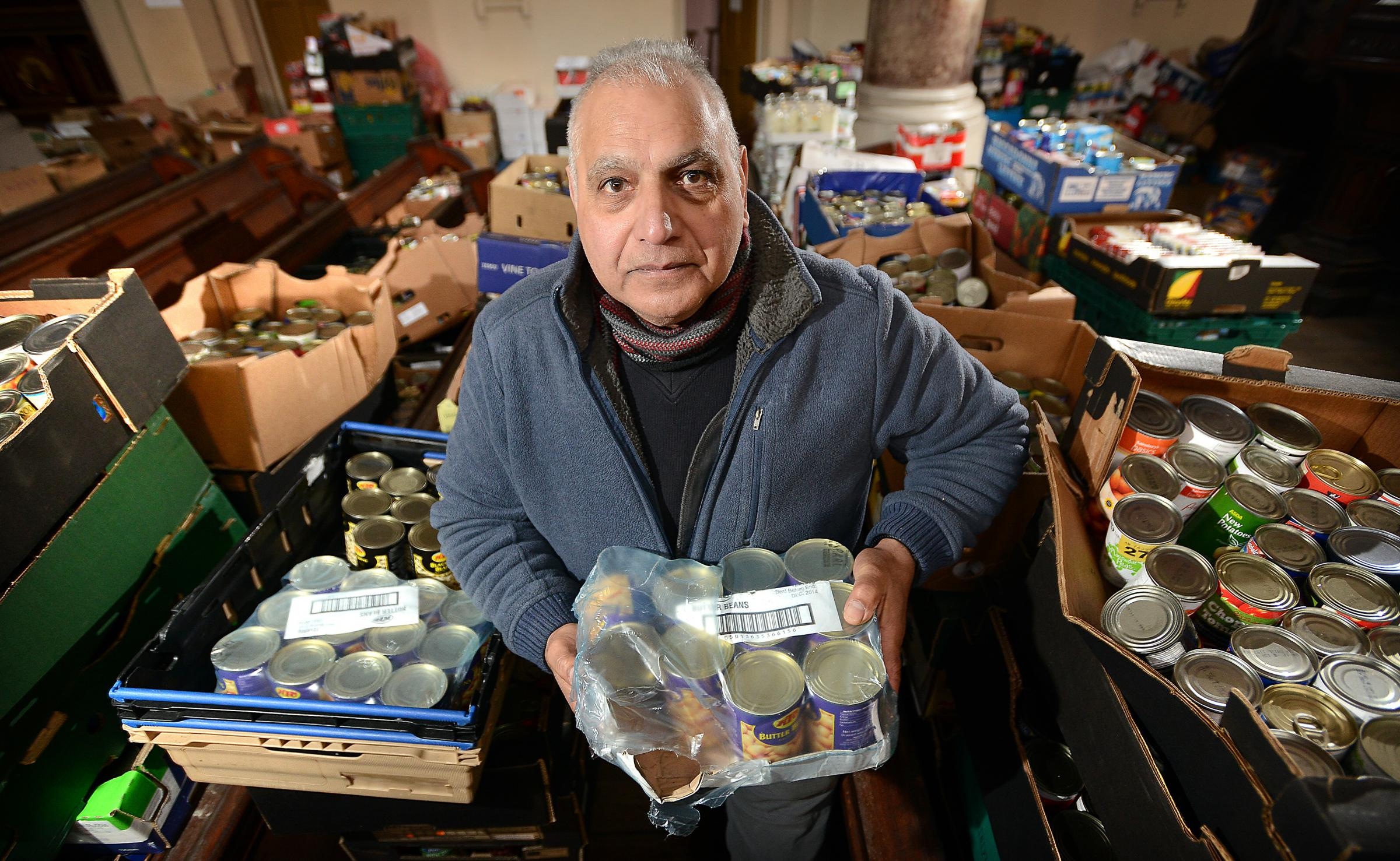Lashman Singh with food bank produce