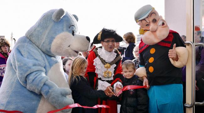 The Lord Mayor of Bradford, Coun Khadim Hussain performed the ribbon cutting with Bookstart Bear, Mia Godward and Ewan Kirk from Carrwood Primary, and Popeye.
