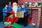 Father Christmas with (from left) All Saints pupils Amarah Ashraf, Blessing Antoine, Ihsan Ali and Ricky Quigley