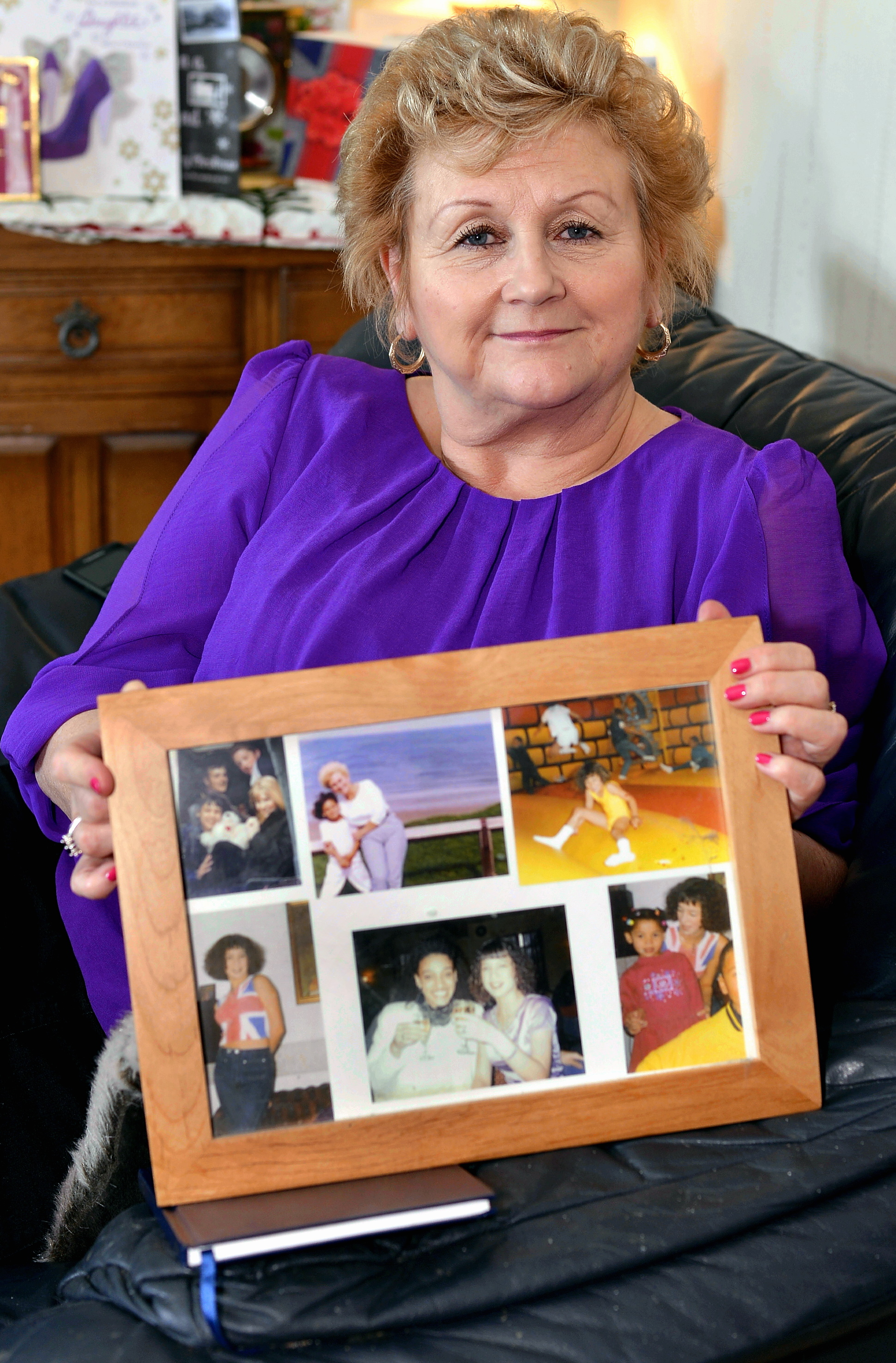Pat Bleau with pictures of her daughter Chantelle