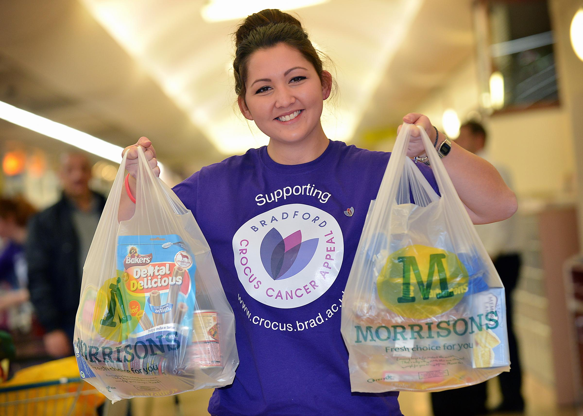Bradford University student Gina Priestley packs bags at Morrisons for the Crocus Cancer Appeal