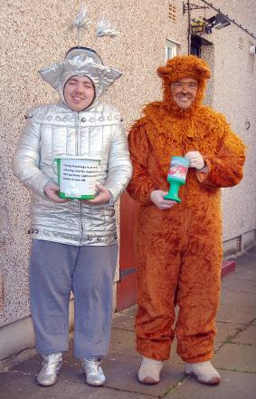 Liam Mackin and dad Dean Little dressed up as Wizard Of Oz characters to collect money in Bradford city centre