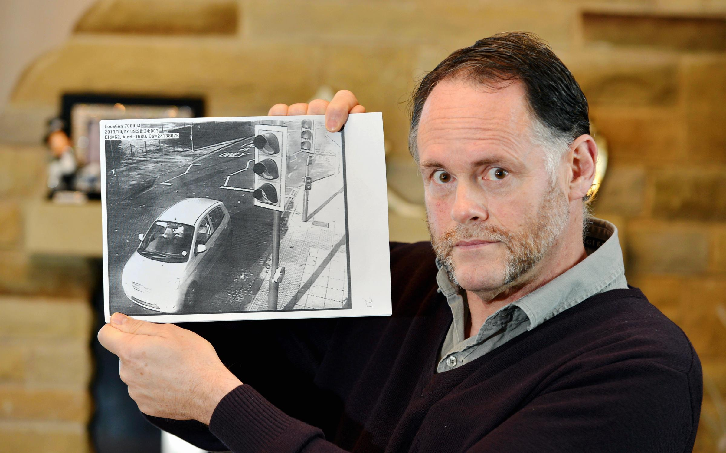 Nigel Dixon with the bus lane camera image of his car, as previously reported in the Telegraph & Argus