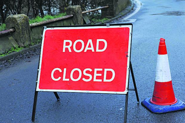 Road closed after pipe bursts