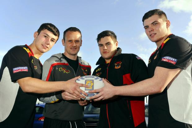 Bulls coach Francis Cummins with, from left, new recruits James Saltonstall, Joe Philbin and Tom Walker