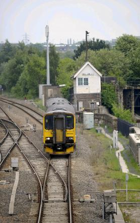 A Northern Rail train is pictured at Mill Lane junction, approaching Bradford Interchange