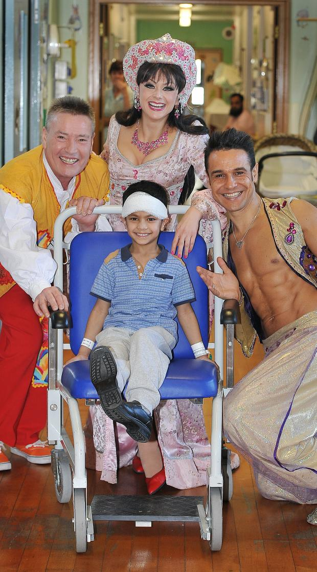 Bradford Telegraph and Argus: Alhambra panto stars Billy Pearce, Jenny Gaynor and Chico visit Safwan Habib