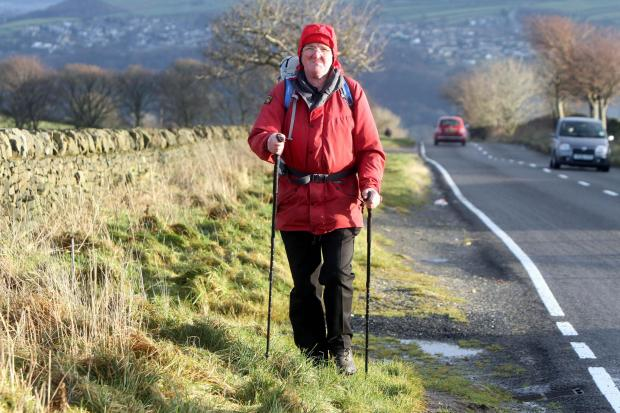 Alex Gardner on the stretch of road leading to Keighley Tarn, on which campaigners want a pavement