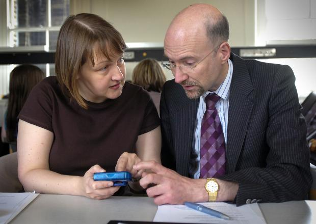 Dr Donald Whitelaw explaining an insulin pump to Liz Finn at an information day at St Luke's Hospital, for patients with Type 1 diabetes