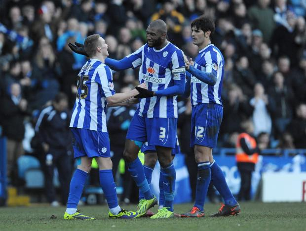 Bradford Telegraph and Argus: Caolan Lavery, left, celebrates scoring Sheffield Wednesday's sixth goal