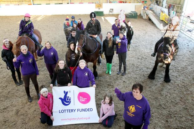 Founder and manager of Haworth RDA Jackie Butterfield (front right) joins staff, volunteers and users to celebrate the Big Lottery Fund grant of £406,751