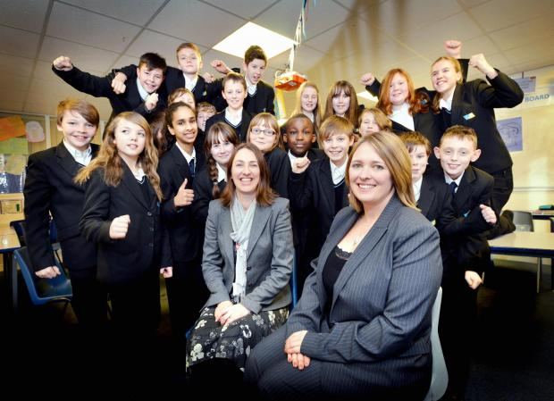 SUCCESS: Whitcliffe Mount head teacher Jennifer Templar (front) and teacher Emma Taylor with delighted pupils