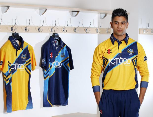 Moin Ashraf models the Yorkshire Vikings home and away shirts, which were among kit auctioned off by the Bradford bowler on Twitter
