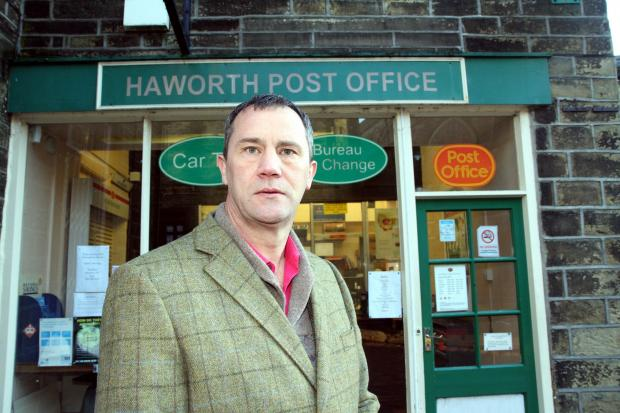 Bradford Telegraph and Argus: Councillor Glen Miller outside Haworth Post Office, which is due to close