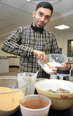 Former Great British Bake Off               contestant, Ali Imdad, at Dixons Allerton Academy, as he hopes to            encourage more        students,              especially young Asian males, to take up the     subject