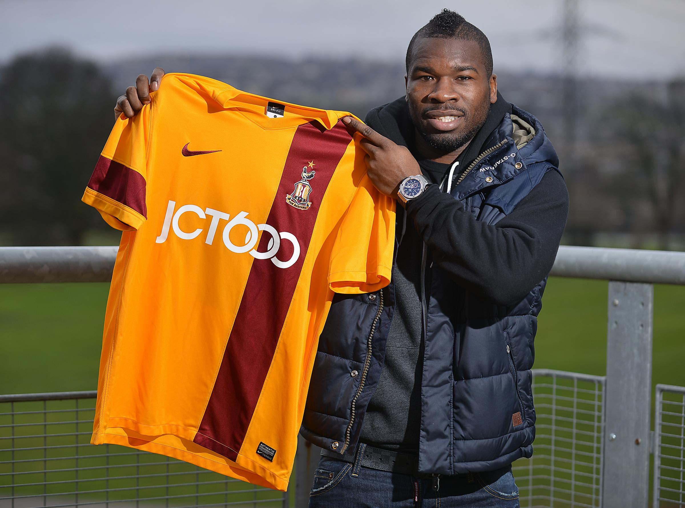 Aaron Mclean poses with a City shirt on his first day training with his new club