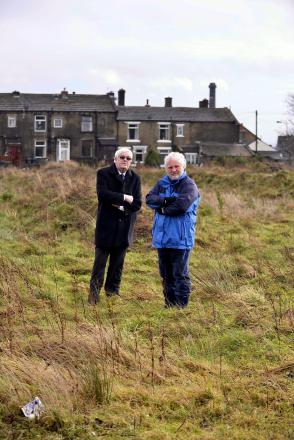 SITE: David Ryan (left) and Councillor Paul Cromie on the site of the new pitch that is still strewn with rubble